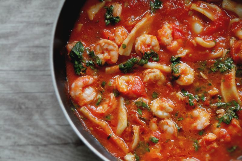 Shrimp and calamari in garlicky tomato sauce. Easy low-carb dinner idea you can make in under 30 minutes!
