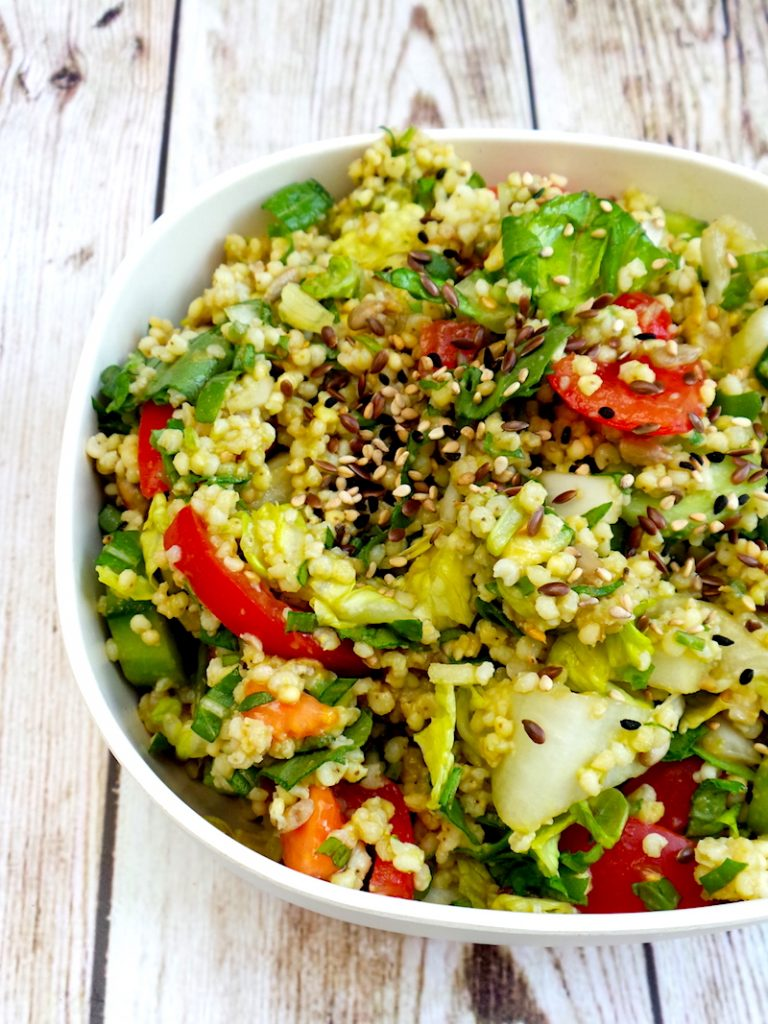Healthy summer salad with avocado and millet! This makes a filling, but light healthy lunch recipe that everyone will love!   www.beautybites.org