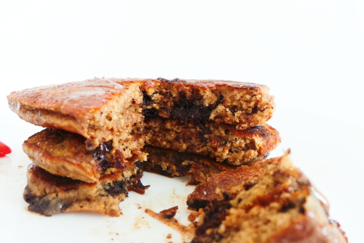 peanut butter chocolate pancake recipe - healthy breakfast idea that is easy to make with ingredients you probably already have at home. Use oats instead of flour and honey instead of sugar to make these healthy pancakes more nutritious.