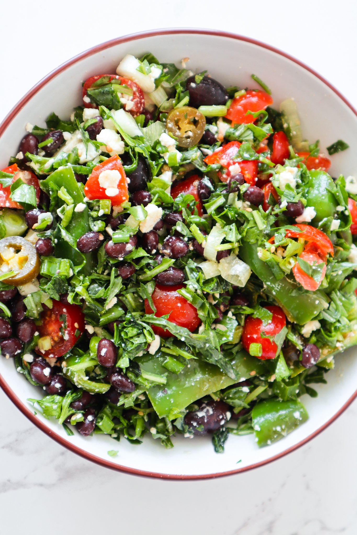 Mediterranean Black bean salad with feta cheese and herbs