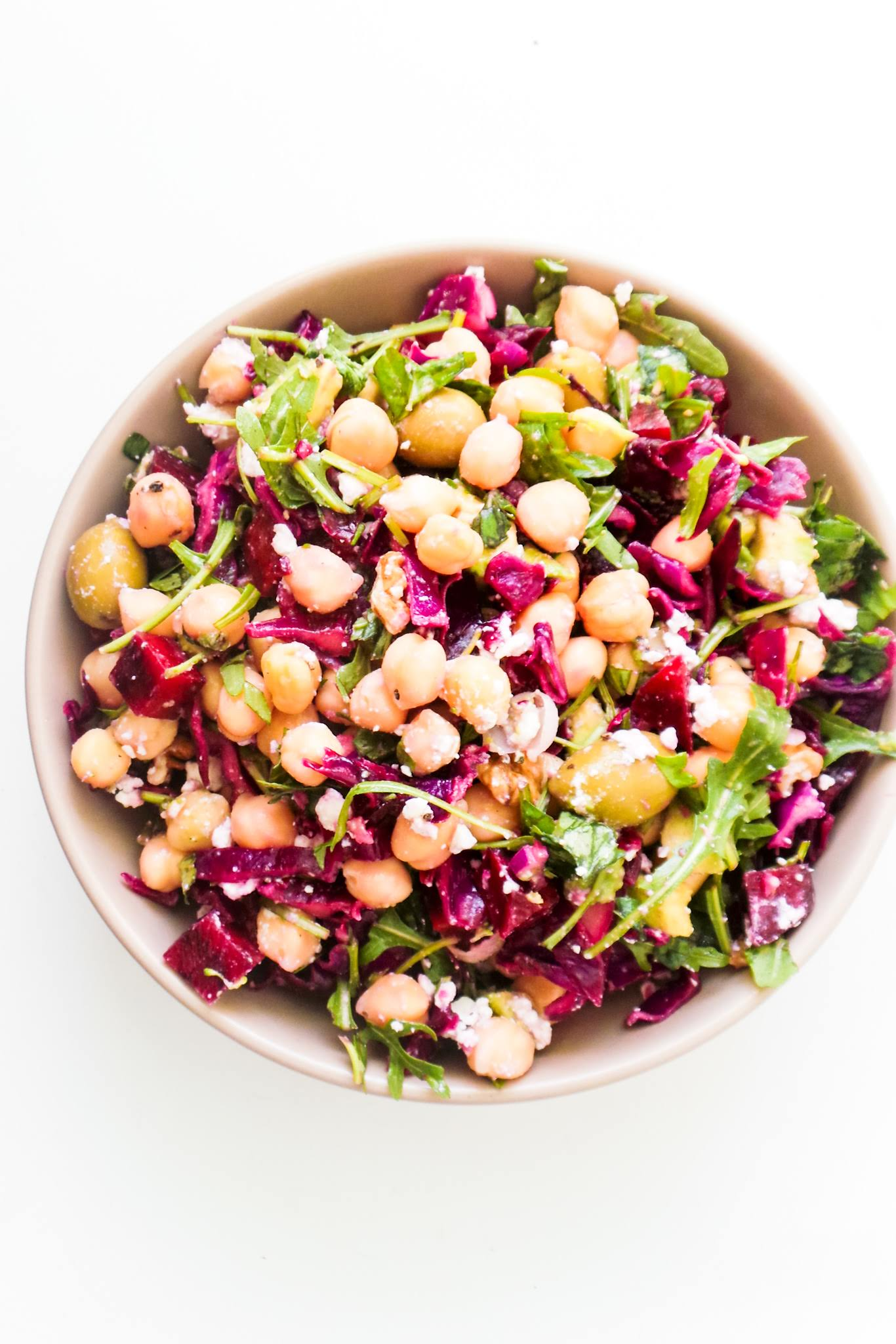 Easy Mediterranean Chickpea Salad recipe! This healthy Mediterranean diet recipe is perfect for lunch or dinner and makes a great clean eating side dish too! With cabbage, chickpeas, olives and beets this healthy salad is filled with antioxidants, protein and fibre and is also a great winter salad recipe! This easy salad recipe is vegetarian and gluten-free, but it's also easily made vegan by leaving out the feta cheese! You need around 15 minutes to make it.