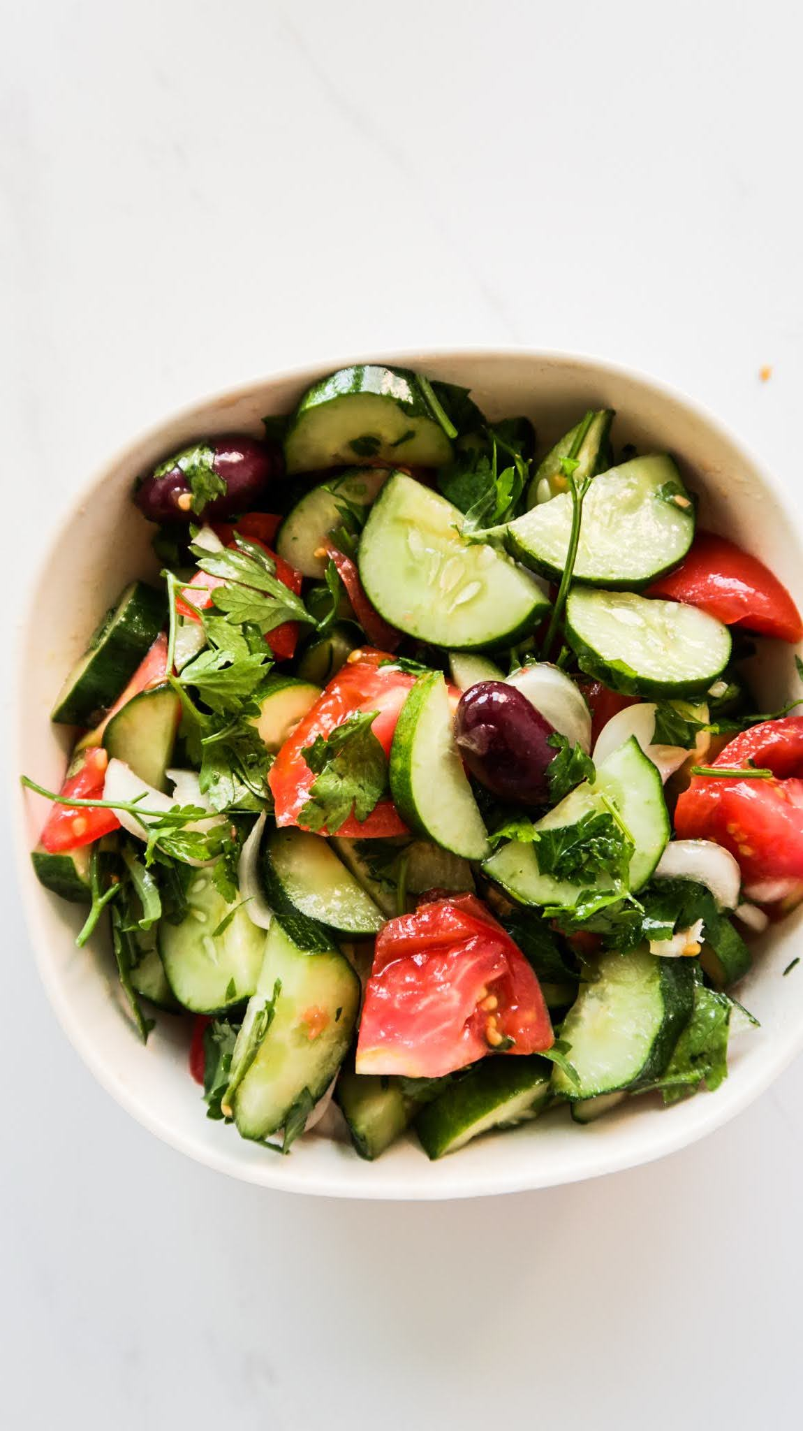 This 5-minute tomato cucumber salad is quick, easy and tasty! It's gluten free, vegan, low carb and it's the best vegetable side dish when tomatoes and cucumbers are in season!
