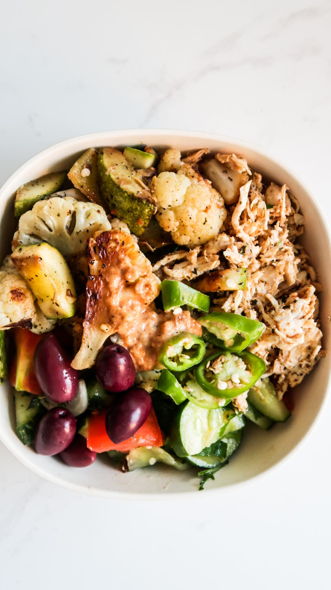 Looking for some new healthy dinner ideas to help you eat clean and reach your health and fitness goals? Try these healthy shredded chicken bowls recipe - it's spicy, delicious, easy to make, gluten free paleo and low carb! Filled with shredded chicken, roasted vegetables and a fresh salad, most of the things for this low carb dinner recipe you can meal prep for the week ahead.