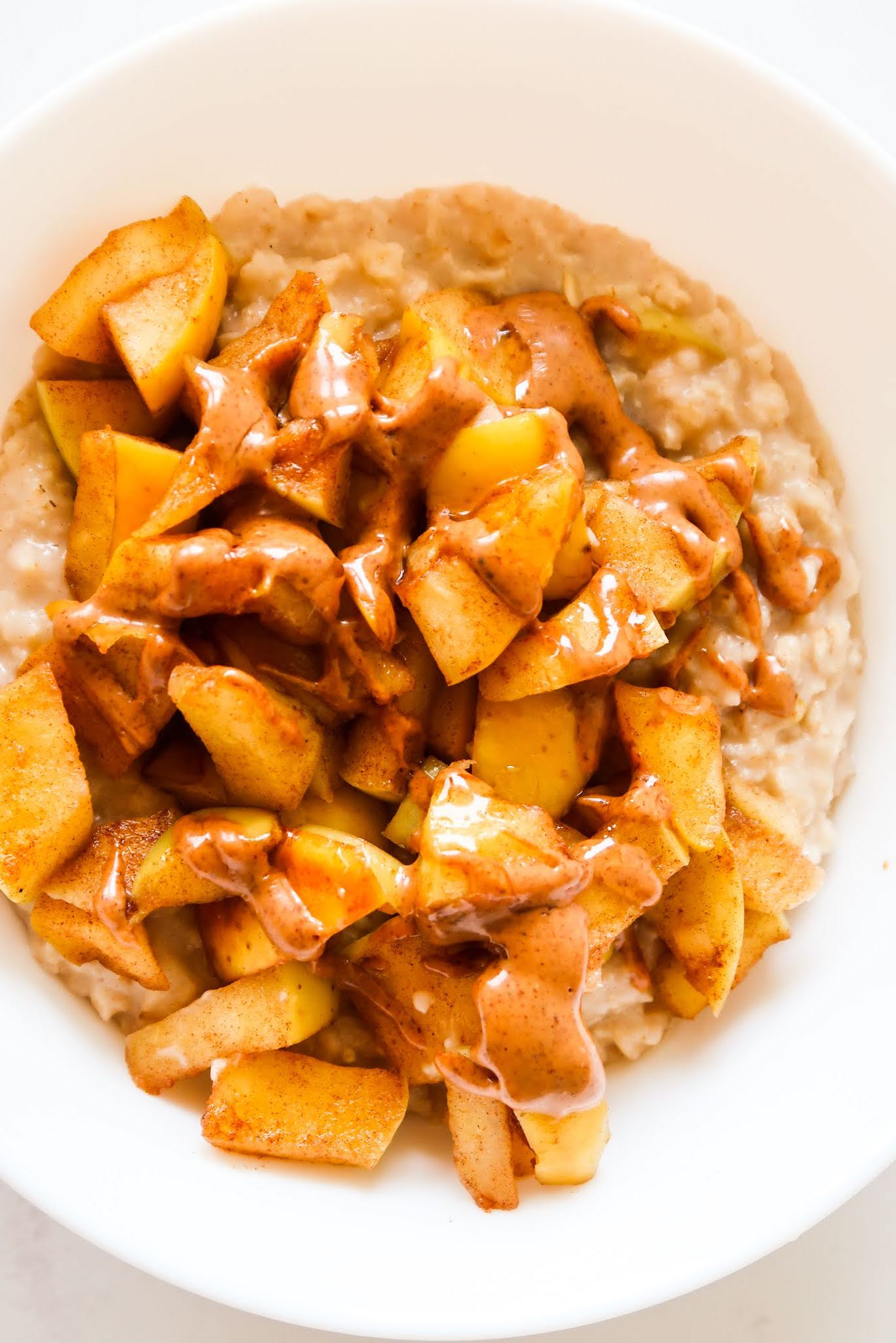 This 10-Minute Apple Pie Oatmeal Recipe is the perfect healthy breakfast idea for the cold months. Quick, easy and delicious clean eating recipe!