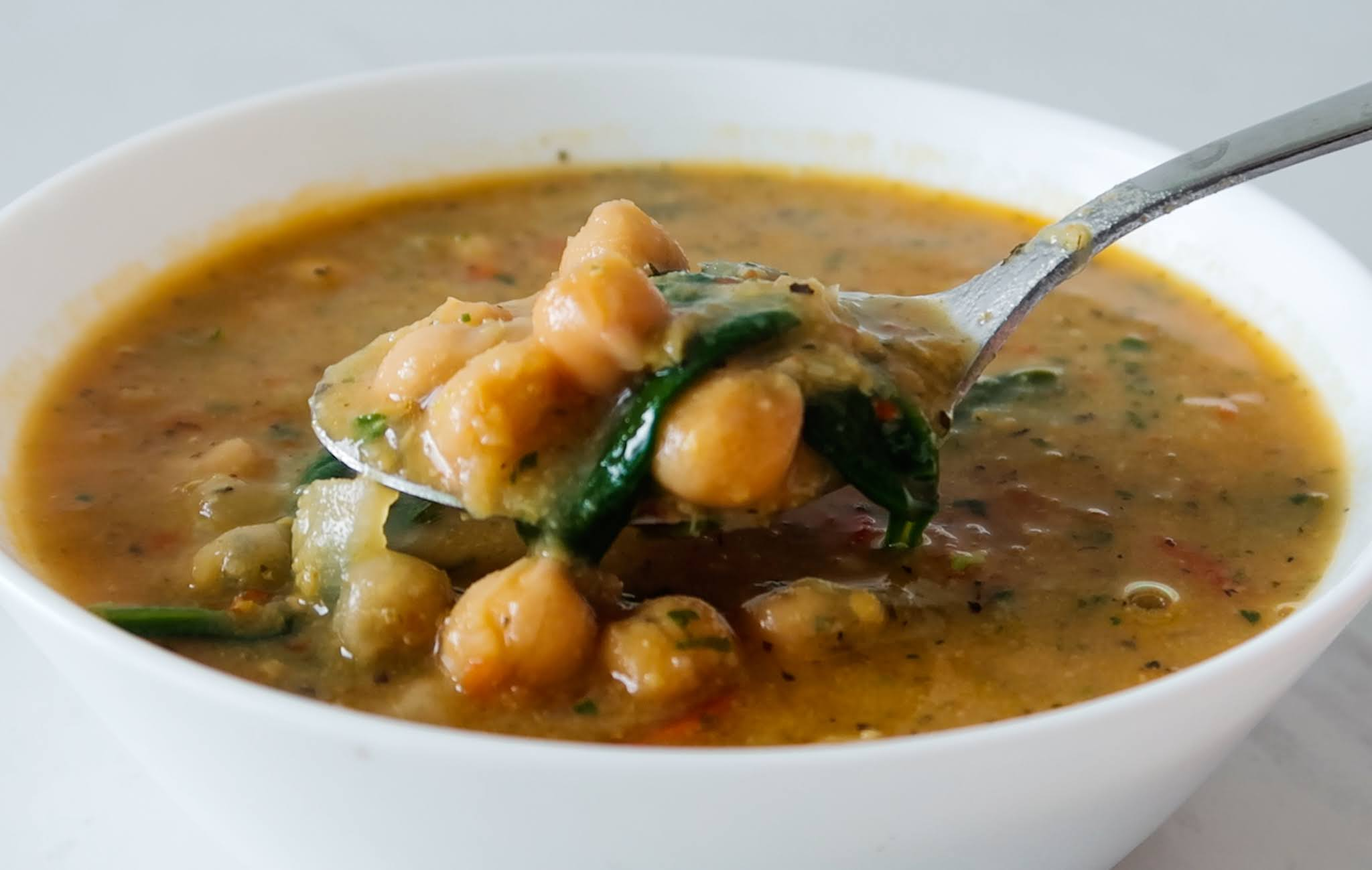 20-minute vegan chickpea soup recipe! Add this tasty and easy soup recipe to your weekly meal plan for dinner or lunch! Quick, healthy, warm and delicious!