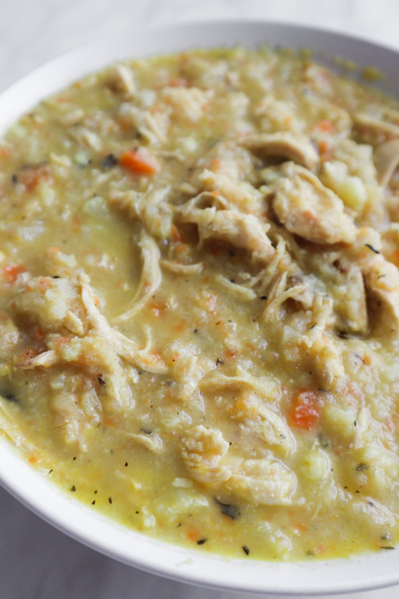 Super easy anti-inflammatory recipe for a delicious cauliflower chicken soup! This homemade soup recipe is light, flavorful, healthy and loaded with anti-inflammatory foods. Perfect healthy dinner idea for busy weeknights as it's ready in around 30 minutes, this clean eating recipe is also low carb, gluten free, dairy free and paleo.