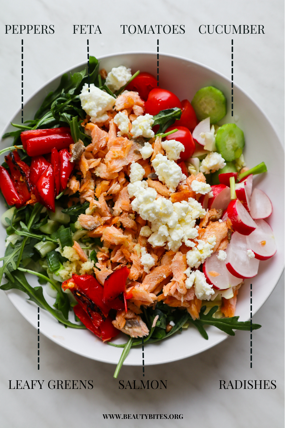 Mediterranean salmon salad recipe! This veggie-packed healthy salad recipe is the perfect summer dinner idea. Filled with a ton of roasted and fresh vegetables, pan-seared salmon and some feta cheese, this easy low carb recipe is full of flavor, antioxidants and it's just delicious. Also easy to meal prep for the week!