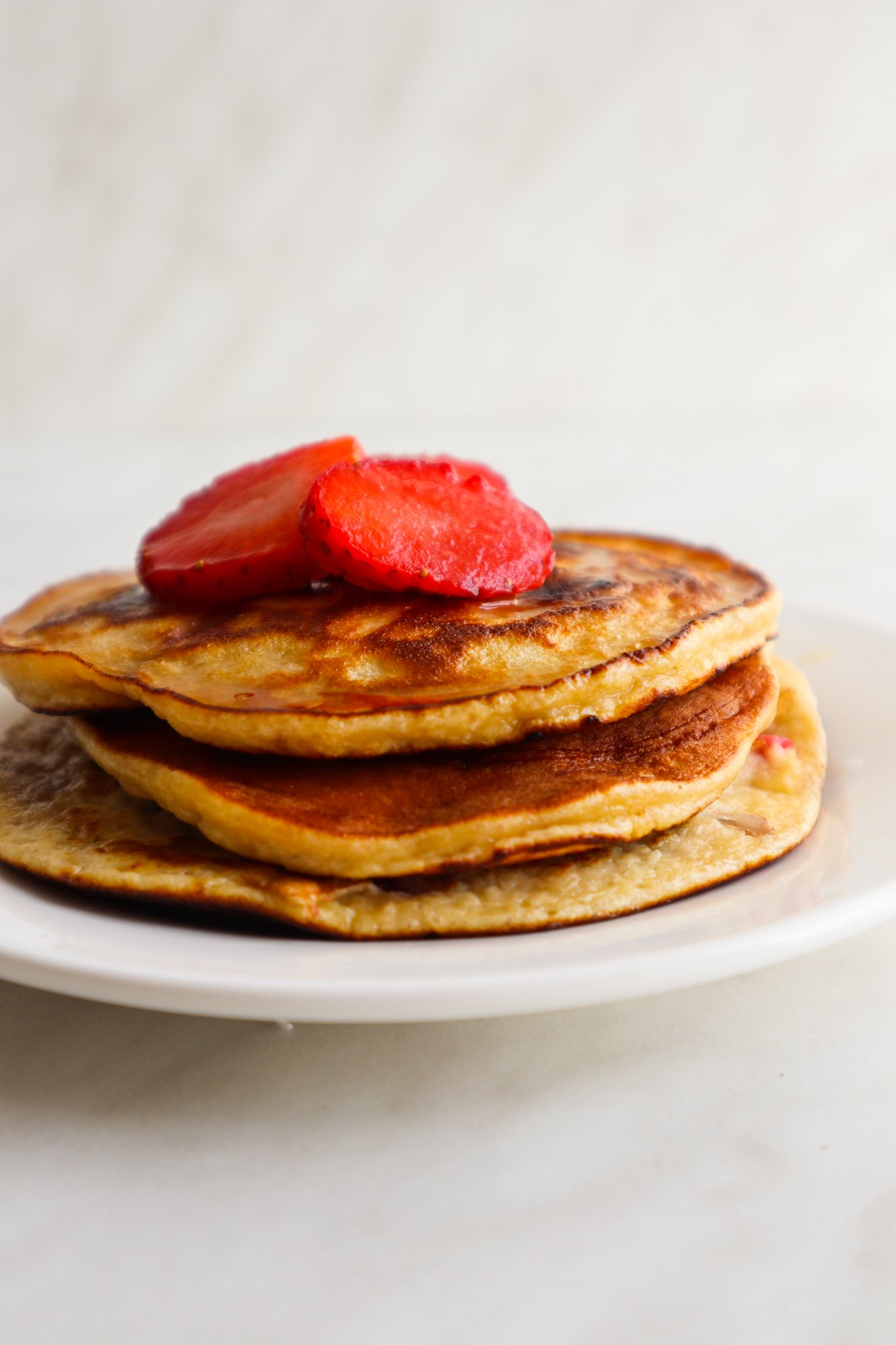 These almond flour strawberry vanilla pancakes are the perfect healthy breakfast idea for one hungry person and you'll love them! This is a delicious dairy free and gluten free breakfast recipe!
