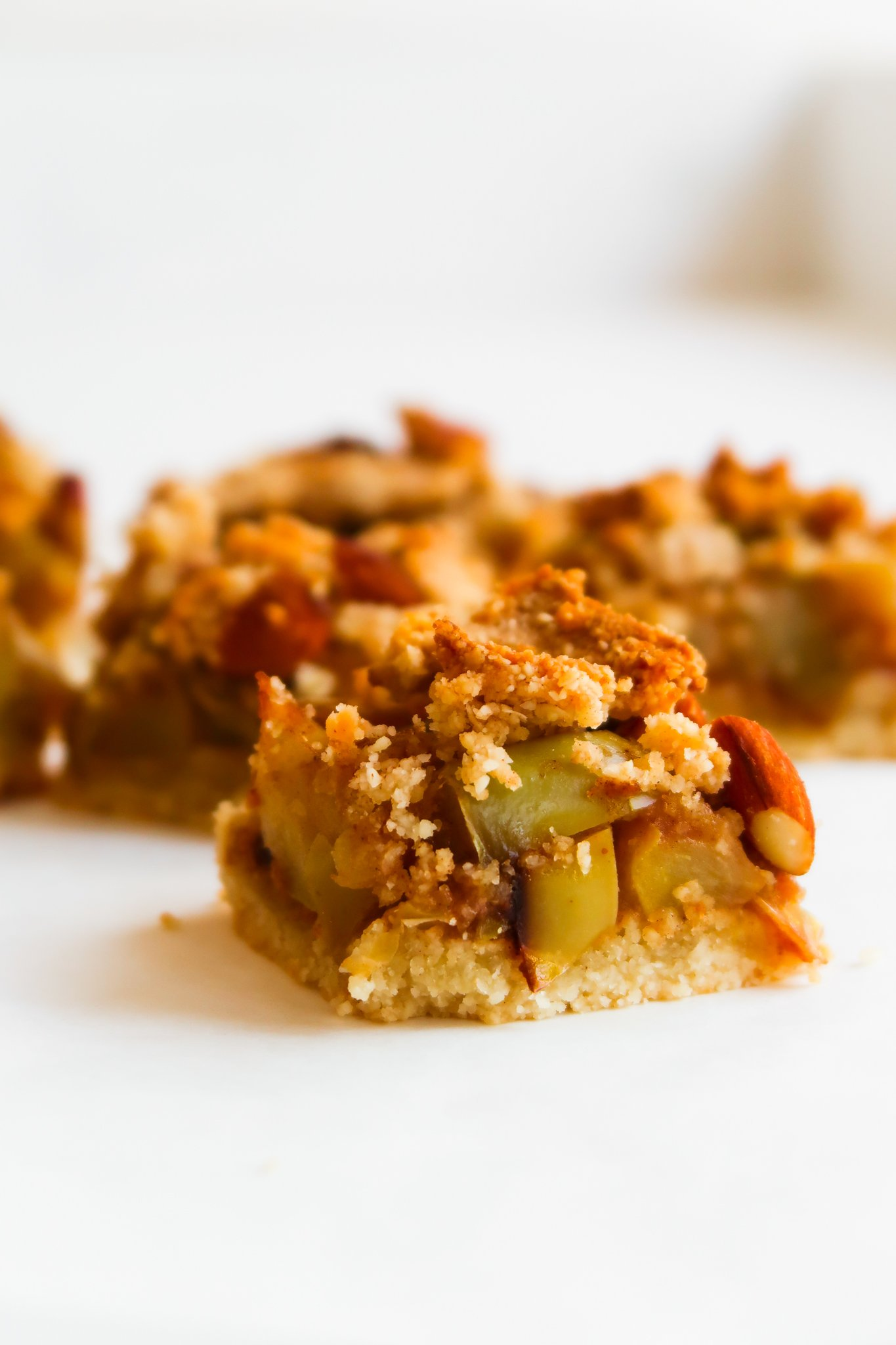 These healthy apple crumble bars are such an easy and delicious fall recipe! Using simple nourishing ingredients like apples, almond flour, maple syrup, coconut oil, and cinnamon, this easy healthy apple recipe is gluten-free, dairy-free, egg-free, paleo, and vegan. It's just the perfect apple dessert or apple breakfast idea!