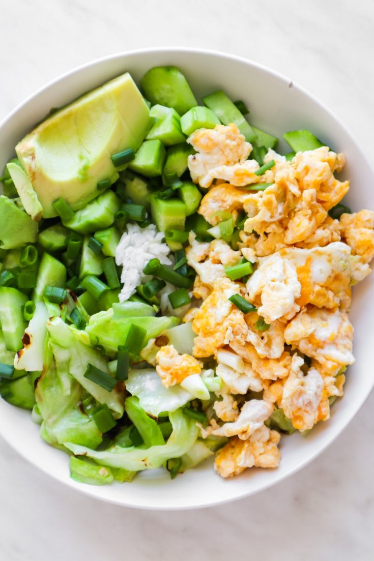 Try this easy breakfast fried rice bowl if you're looking for some new healthy breakfast ideas! This tasty rice bowl is a great savory meal prep breakfast idea that won't leave you hungry.