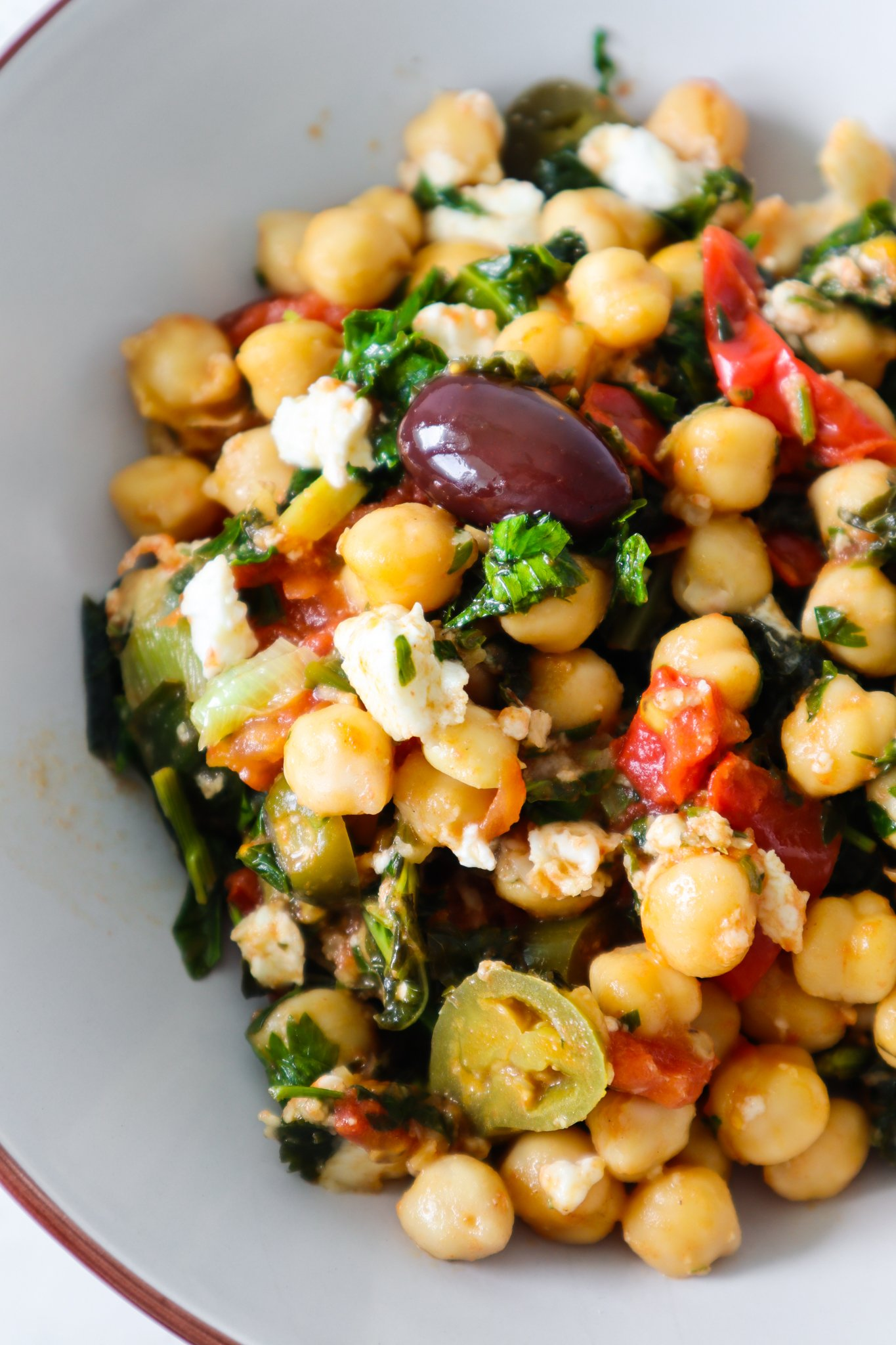 Easy healthy chickpea recipes! We've got vegan chickpea dinner recipes that you can make in one pan, healthy chickpea salads, a comforting chickpea soup and even a vegan chickpea dessert. So grab a can of garbanzo beans and try some of these vegetarian recipes!