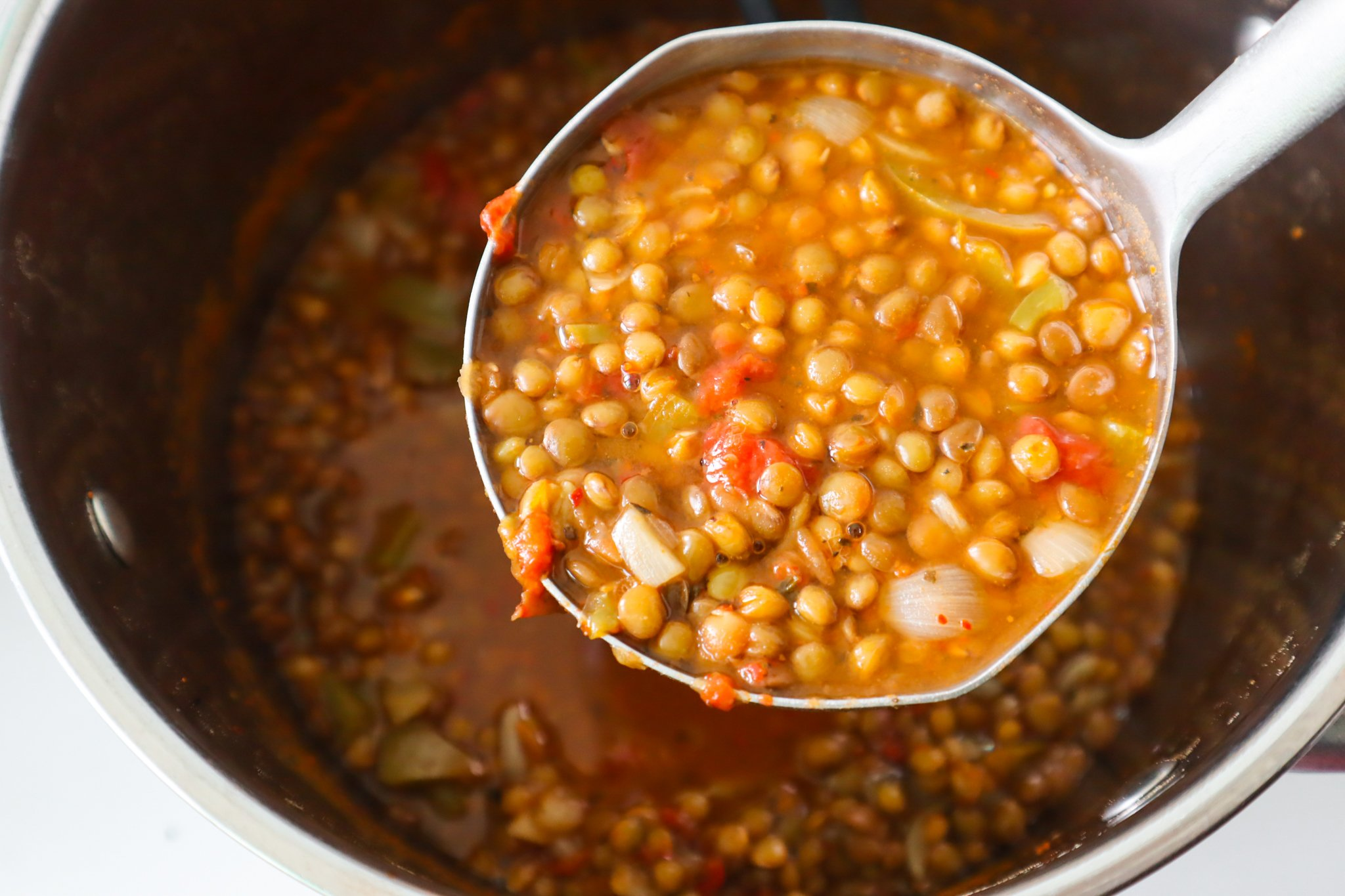 You can make this easy vegan lentil soup recipe in about 30 minutes using simple, healthy ingredients that include dried lentils, tomatoes, peppers and onion! This tasty lentil recipe is a great plant-based meal prep recipe and is low in calories, filling, delicious, gluten free, nut free and soy free.