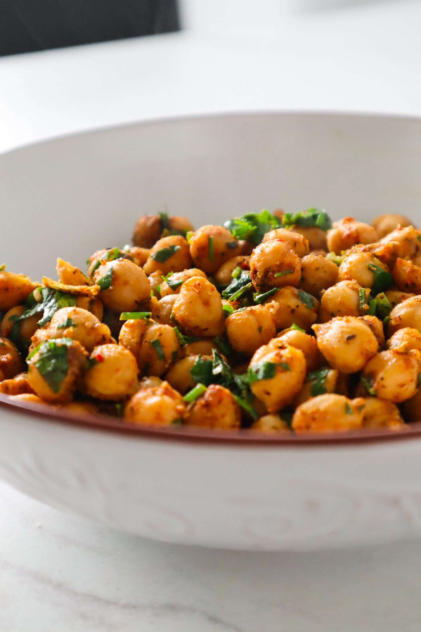 Spicy chickpeas! Ready in 5 minutes this easy chickpea recipe is made with canned chickpeas, is gluten free vegan and will be great for weekly vegan meal prep!